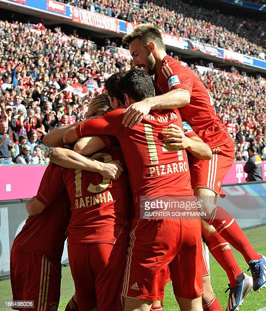 Bayern Munich's Brazilian defender Rafinha celebrates scoring with teammates during the German first division Bundesliga football match FC Bayern...