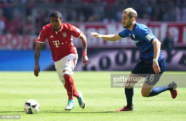 Bayern Munich's Brazilian midfielder Douglas Costa and Darmstadt's Bosnian midfielder Mario Vrancic vie for the ball during the German First division...