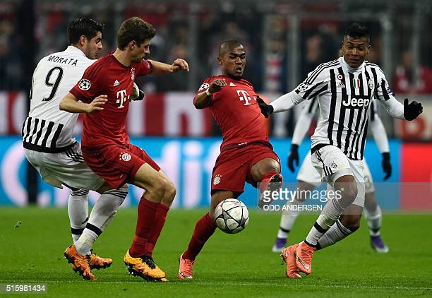 Bayern Munich's Brazilian midfielder Douglas Costa and Juventus' defender from Brazil Alex Sandro vie for the ball during the UEFA Champions League...