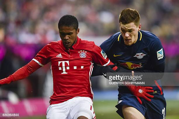 Bayern Munich's Brazilian midfielder Douglas Costa and Leipzig's defender Marcel Halstenberg vie for the ball during the German first division...