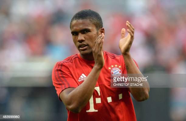 Bayern Munich's Brazilian midfielder Douglas Costa applauds prior to the German first division Bundesliga football match FC Bayern Munich vs...