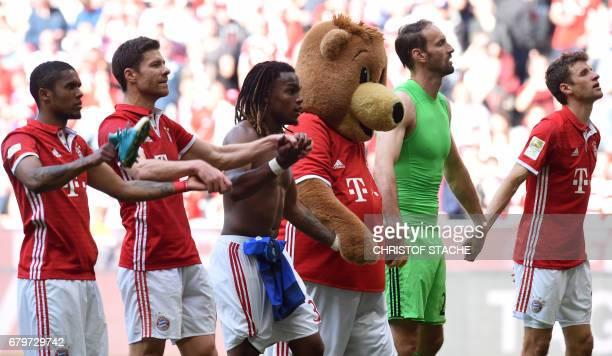 Bayern Munich's Brazilian midfielder Douglas Costa Bayern Munich's Spanish midfielder Xabi Alonso Bayern MunichÕs Portuguese midfielder Renato...