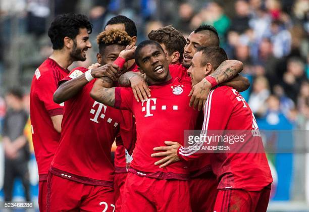 Bayern Munich's Brazilian midfielder Douglas Costa celebrates scoring his sides second goal during the German first division Bundesliga football...