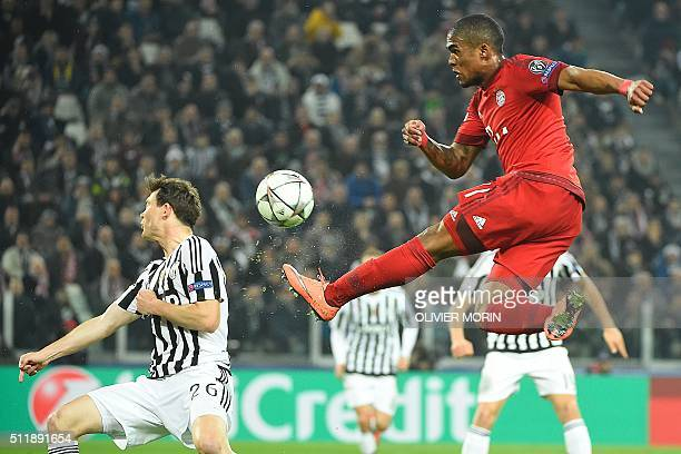 Bayern Munich's Brazilian midfielder Douglas Costa kicks the ball past Juventus' Swiss defender Stephan Lichtsteiner during the UEFA Champions League...