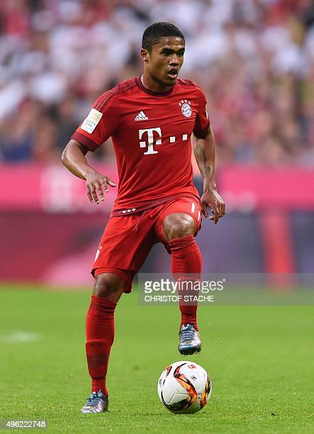 Bayern Munich's Brazilian midfielder Douglas Costa plays the ball during the German first division football Bundesliga match between FC Bayern Munich...