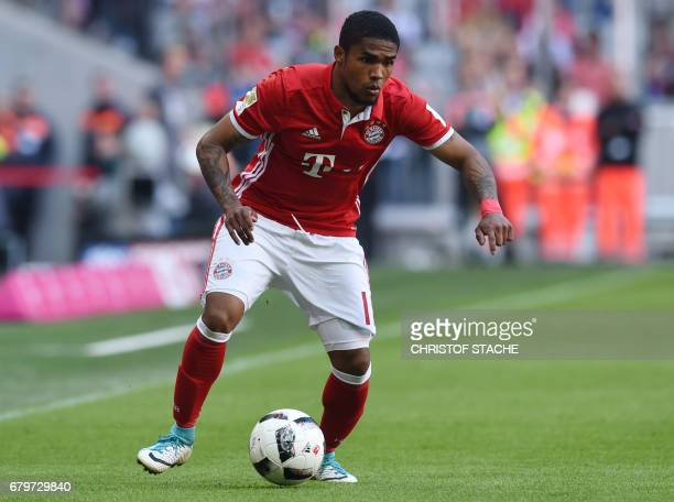 Bayern Munich's Brazilian midfielder Douglas Costa plays the ball during the German First division Bundesliga football match Bayern Munich vs...