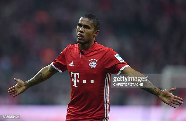 Bayern Munich's Brazilian midfielder Douglas Costa reacts after his goal during the German first division Bundesliga football match between FC Bayern...