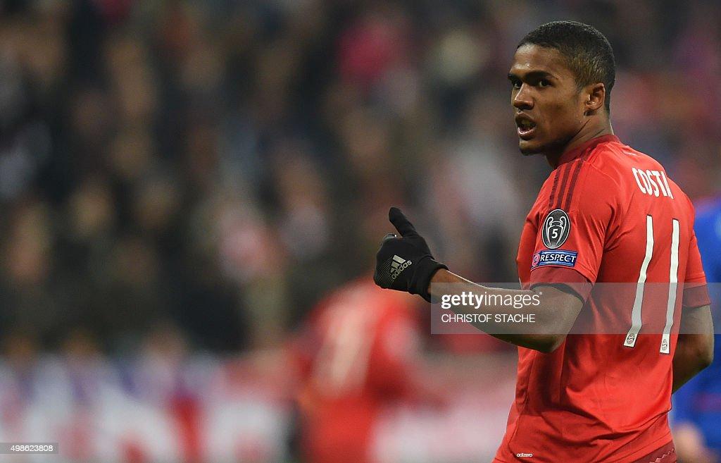 Bayern Munich's Brazilian midfielder Douglas Costa reacts during the UEFA Champions League Group F football match between FCB Bayern Munich and...