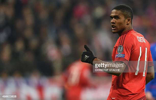 Bayern Munich's Brazilian midfielder Douglas Costa reacts during the UEFA Champions League Group F football match between FCB Bayern Munich and...