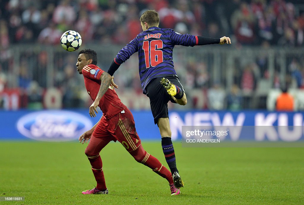 Bayern Munich's Brazilian midfielder Luiz Gustavo (L) and Arsenal´s Welsh midfielder Aaron Ramsey (R) vie for the ball during the UEFA Champions League Round of 16 second-leg football match FC Bayern Munich vs FC Arsenal London in Munich, southern Germany, on March 13, 2013.