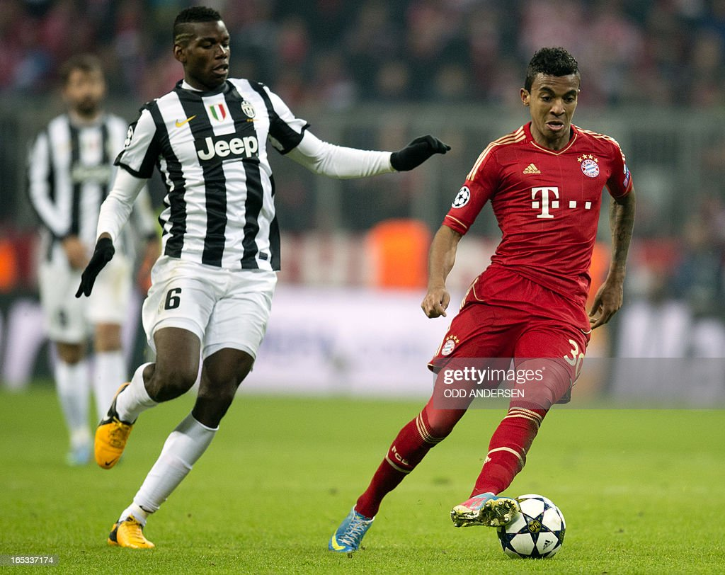 Bayern Munich's Brazilian midfielder Luiz Gustavo (R) and Juventus' French midfielder Paul Pogba vie for the ball during the UEFA Champions league first leg quarter final football match between Bayern Munich and Juventus at the Allianz arena in Munich on April 2, 2013. Bayern defeated Juventus 2-0. AFP PHOTO / ODD ANDERSEN