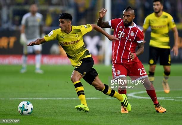 Bayern Munich's Chilean midfielder Arturo Vidal and Dortmund's midfielder Mahmoud Dahoud vie for the ball during the German Supercup football match...