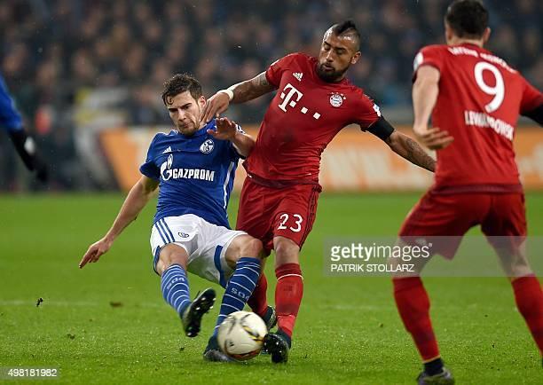 Bayern Munich's Chilean midfielder Arturo Vidal and Schalke's midfielder Leon Goretzka vie for the ball during the German first division Bundesliga...