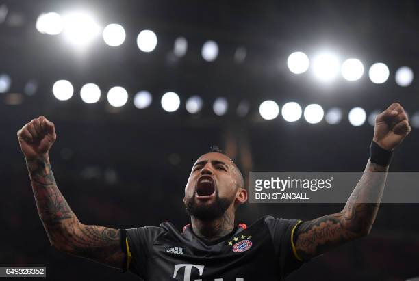 TOPSHOT Bayern Munich's Chilean midfielder Arturo Vidal celebrates after scoring their fifth goal during the UEFA Champions League last 16 second leg...