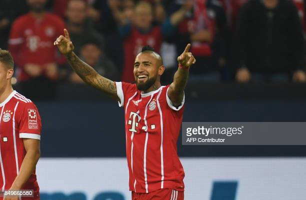 Bayern Munich's Chilean midfielder Arturo Vidal celebrates during the German First division Bundesliga football match between FC Schalke 04 and FC...