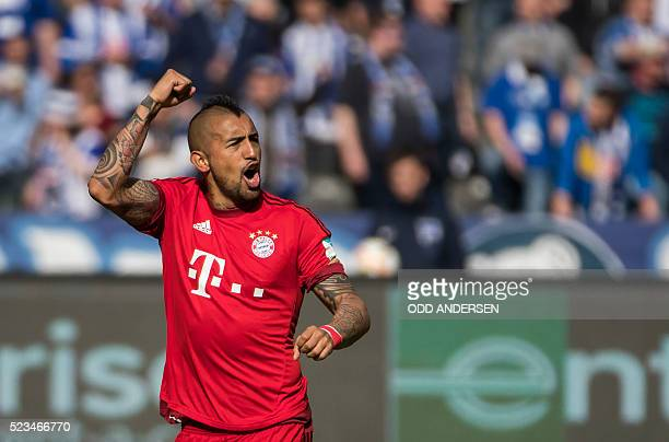 Bayern Munich's Chilean midfielder Arturo Vidal celebrates scoring his sides opening goal during the German first division Bundesliga football match...