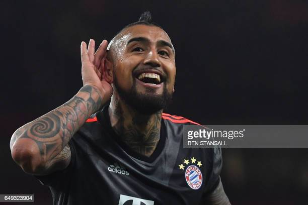 TOPSHOT Bayern Munich's Chilean midfielder Arturo Vidal celebrates scoring their fourth goal during the UEFA Champions League last 16 second leg...