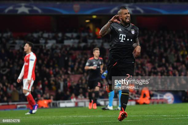 Bayern Munich's Chilean midfielder Arturo Vidal celebrates scoring their fourth goal during the UEFA Champions League last 16 second leg football...