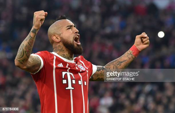 Bayern Munich's Chilean midfielder Arturo Vidal celebrates scoring the opening goal during the German first division Bundesliga football match Bayern...