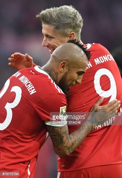 Bayern Munich's Chilean midfielder Arturo Vidal embraces his teammate Polish striker Robert Lewandowski after the second goal for Munich during the...