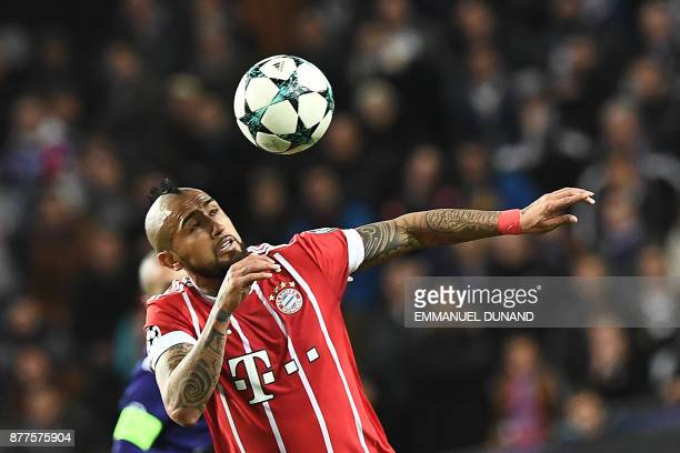 Bayern Munich's Chilean midfielder Arturo Vidal heads the ball during the UEFA Champions League Group B football match between Anderlecht and Bayern...