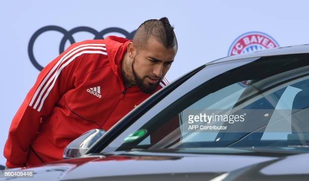 Bayern Munich's Chilean midfielder Arturo Vidal looks in to a car during a car handover event at the Audi headquarters in Ingolstadt southern Germany...
