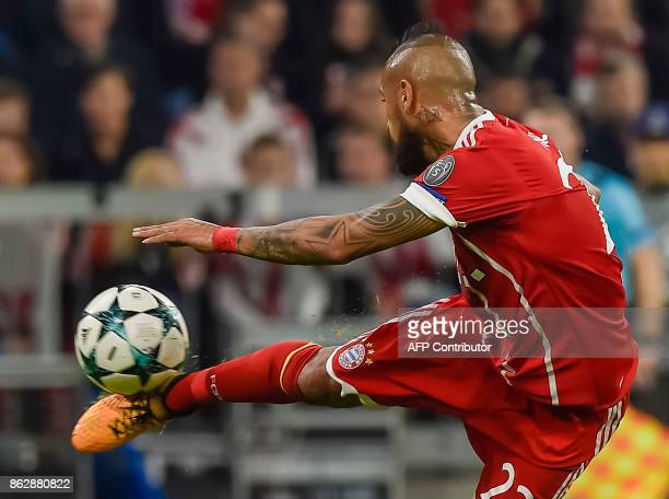 Bayern Munich's Chilean midfielder Arturo Vidal plays the ball during the Champions League group B match between FC Bayern Munich and Celtic Glasgow...