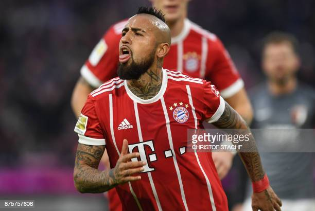 Bayern Munich's Chilean midfielder Arturo Vidal reacts after scoring during the German first division Bundesliga football match Bayern Munich vs FC...