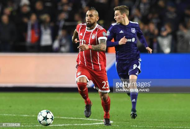 Bayern Munich's Chilean midfielder Arturo Vidal runs with the ball during the UEFA Champions League Group B football match between Anderlecht and...