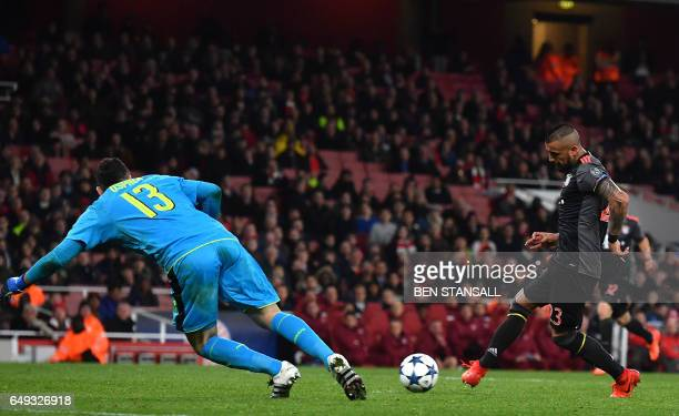 Bayern Munich's Chilean midfielder Arturo Vidal scores their fifth goal and his second past Arsenal's Colombian goalkeeper David Ospina during the...
