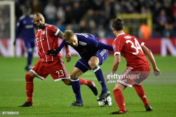 Bayern Munich's Chilean midfielder Arturo Vidal vies with Anderlecht's Polish forward Lukasz Teodorczyk during the UEFA Champions League Group B...