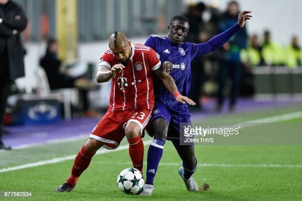 Bayern Munich's Chilean midfielder Arturo Vidal vies with Anderlecht's French defender Dennis Appiah during the UEFA Champions League Group B...