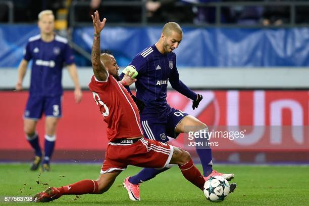 Bayern Munich's Chilean midfielder Arturo Vidal vies with Anderlecht's Algerian midfielder Sofiane Hanni during the UEFA Champions League Group B...