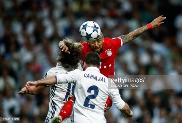 Bayern Munich's Chilean midfielder Arturo Vidal vies with Real Madrid's Croatian midfielder Luka Modric and Real Madrid's defender Dani Carvajal...