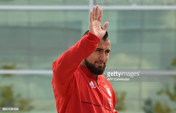 Bayern Munich's Chilean midfielder Arturo Vidal waves during a car handover event at the Audi headquarters in Ingolstadt southern Germany on October...