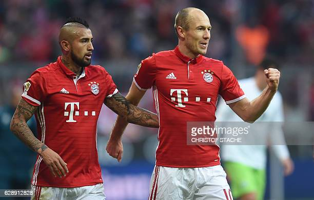 Bayern Munich's Chilian midfielder Arturo Vidal and Bayern Munich's Dutch midfielder Arjen Robben celebrate after the first goal for Munich during...