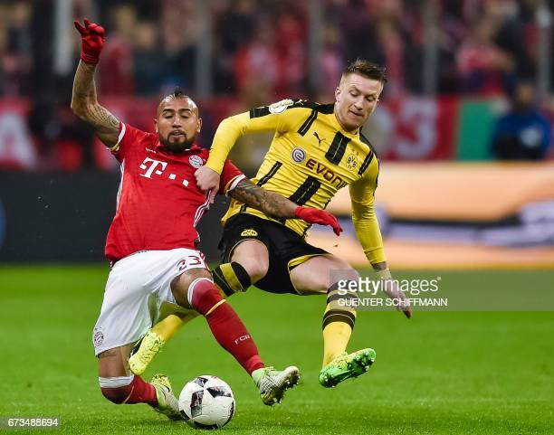 Bayern Munich's Chilian midfielder Arturo Vidal and Dortmund's German striker Marco Reus vie for the ball during the German Cup DFB Pokal semifinal...