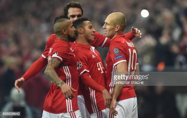Bayern Munich's Chilian midfielder Arturo Vidal Bayern MunichÕs defender Mats Hummels Bayern Munich's Spanish midfielder Thiago Alcantara and Bayern...