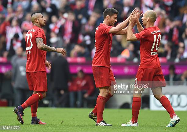Bayern Munich's Chilian midfielder Arturo Vidal Bayern Munich's Spanish midfielder Xabi Alonso and Bayern Munich's Dutch midfielder Arjen Robben...