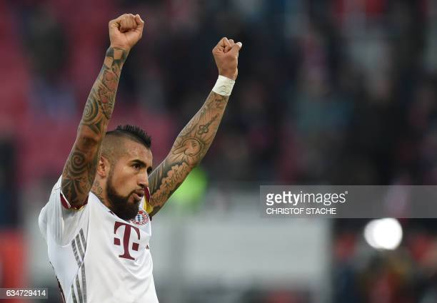 Bayern Munich's Chilian midfielder Arturo Vidal celebrates after the German First division Bundesliga football match between FC Ingolstadt 04 and FC...