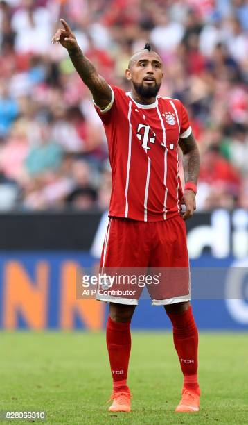 Bayern Munich's Chilian midfielder Arturo Vidal gestures during the third place Audi Cup football match between SSC Napoli and Bayern Munich in the...