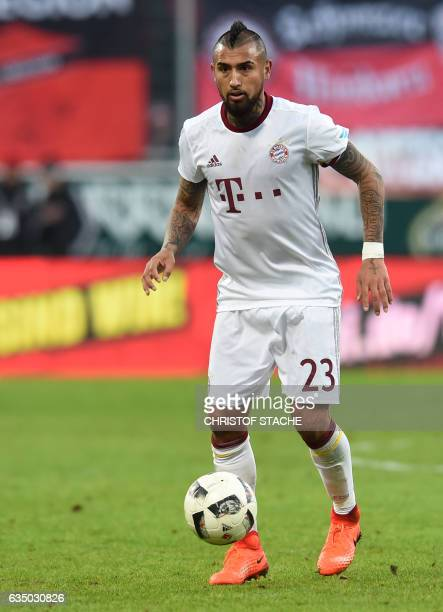 Bayern Munich's Chilian midfielder Arturo Vidal plays the ball during the German First division Bundesliga football match between FC Ingolstadt 04...
