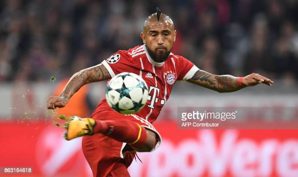 Bayern Munich's Chilian midfielder Arturo Vidal plays the ball during the Champions League group B match between Bayern Munich and Celtic Glasgow in...