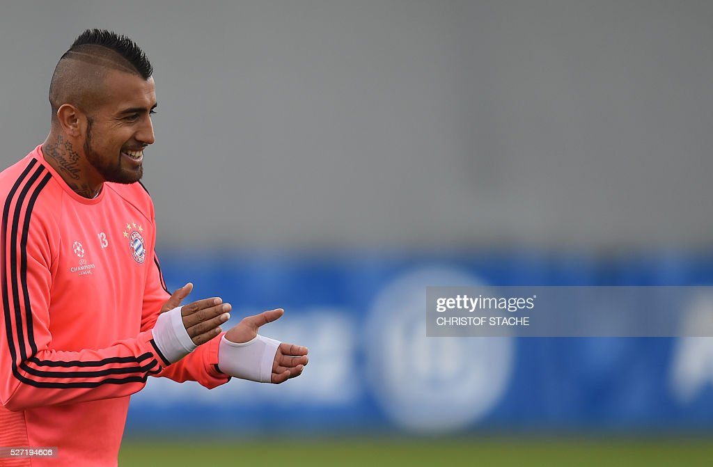 Bayern Munich's Chilian midfielder Arturo Vidal takes part in the final team training session one day prior to the Champions League semi-final, second-leg football match between Bayern Munich and Atletico Madrid at the club trainings area in Munich, southern Germany, on May 2, 2016. / AFP / CHRISTOF