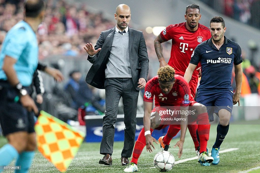 Bayern Munich's Coach Pep Guardiola gestures during the Champions League semifinal second leg soccer match between FC Bayern Munich and Atletico Madrid at the Allianz Arena on May 3, 2016, in Munich, Germany.