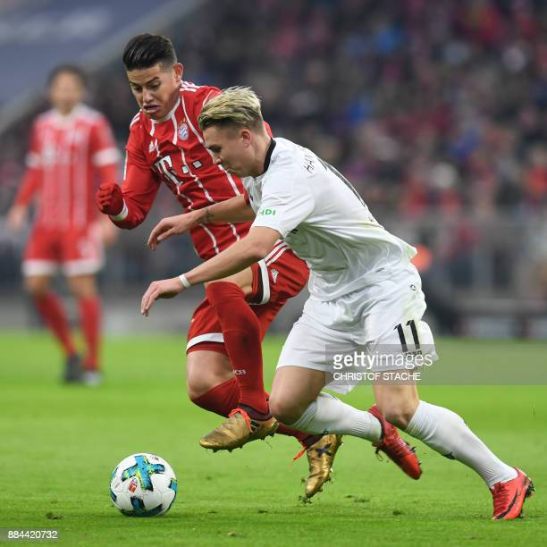 Bayern Munich's Colombian James Rodriguez and Hanover's midfielder Felix Klaus during the German First division Bundesliga football match Bayern...