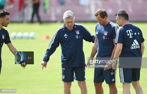 Bayern Munich's Cotrainer Davide Ancelotti Bayern Munich's Italian head coach Carlo Ancelotti cotrainer Willy Sagnol and goalkeeper trainer Toni...