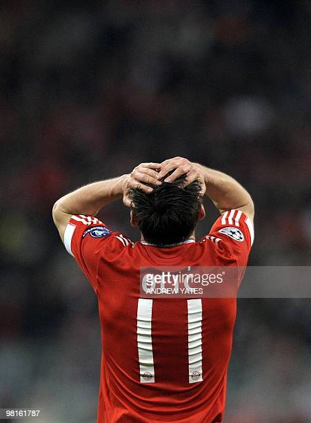 Bayern Munich's Croatian forward Ivica Olic reacts after a missed chance during the UEFA Champions League 1st leg quarterfinal match FC Bayern Munich...