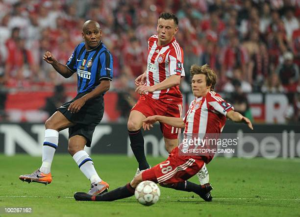 Bayern Munich's Croatian striker Ivica Olic and Bayern Munich's defender Holger Badstuber vie for the ball with Inter Milan's Brazilian defender...