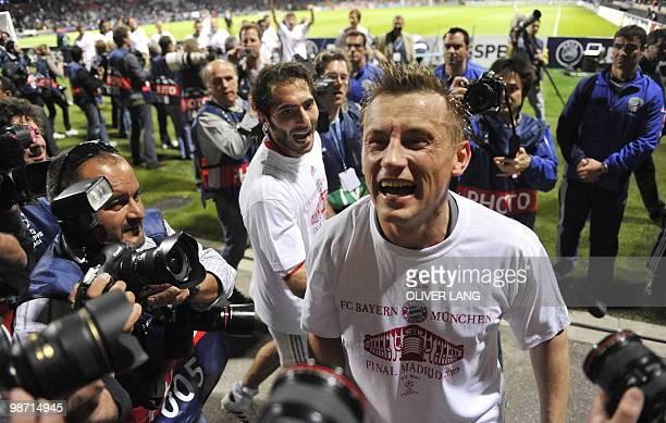 Bayern Munich's Croatian striker Ivica Olic and Bayern Munich's Turkish midfielder Hamit Altintop celebrate after the 2nd leg UEFA Champions League...